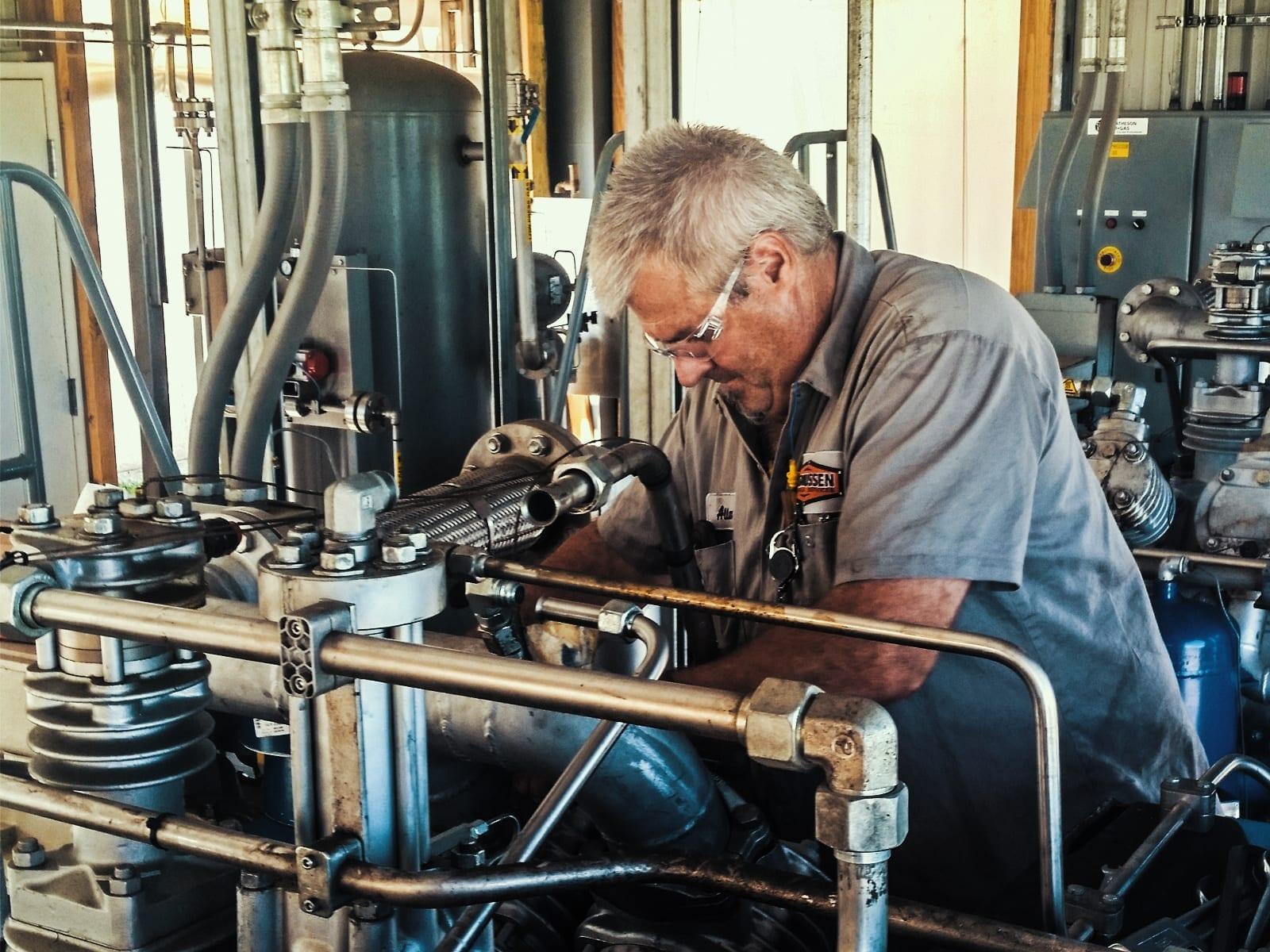 man doing preventative maintenance on air services