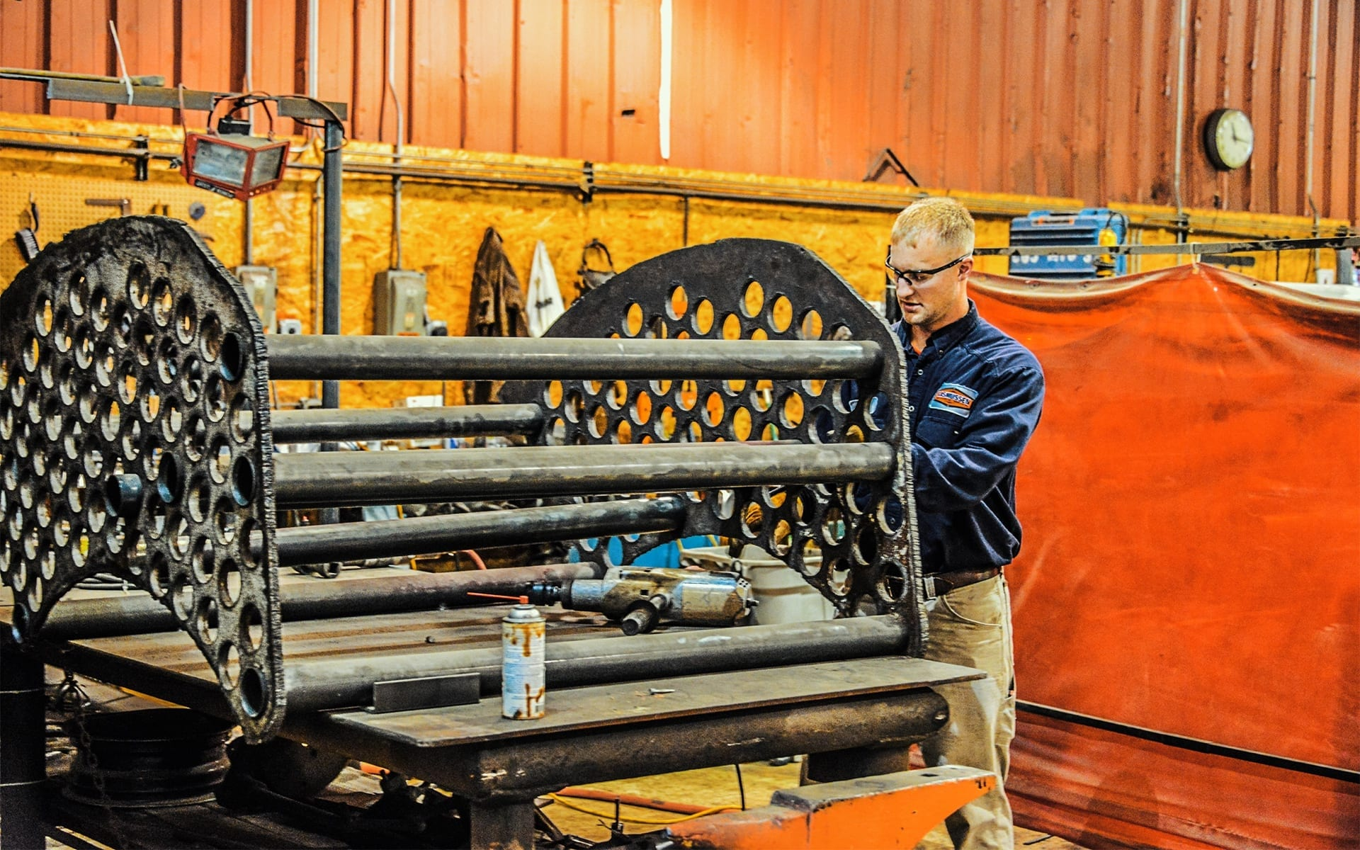 RMS tech performing boiler repair by cleaning boiler tubes