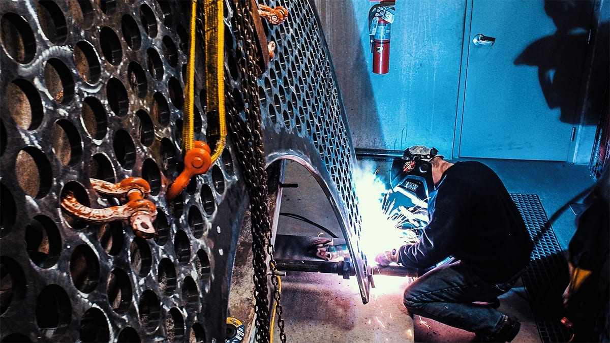 Technician performing commercial Boiler Repair Welding