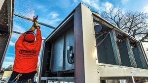 Performing Services on a chiller system outside.