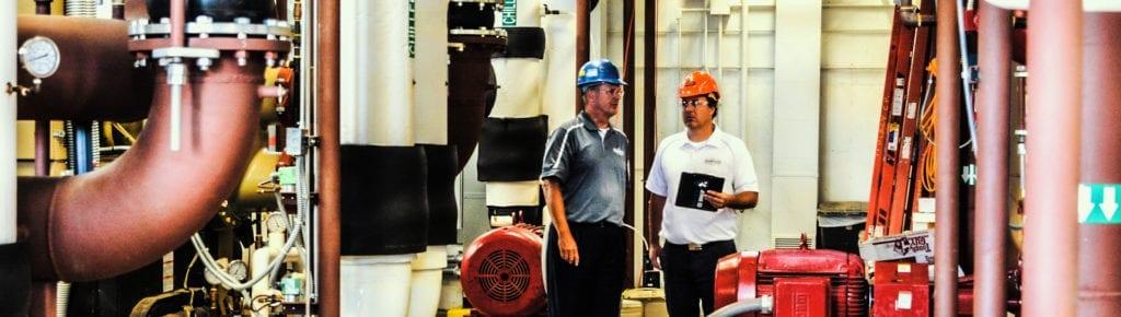 Rasmussen mechanical repair experts executing maintenance on a boiler.