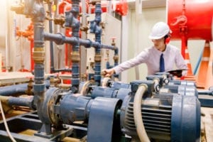 Guy checking industrial chiller system