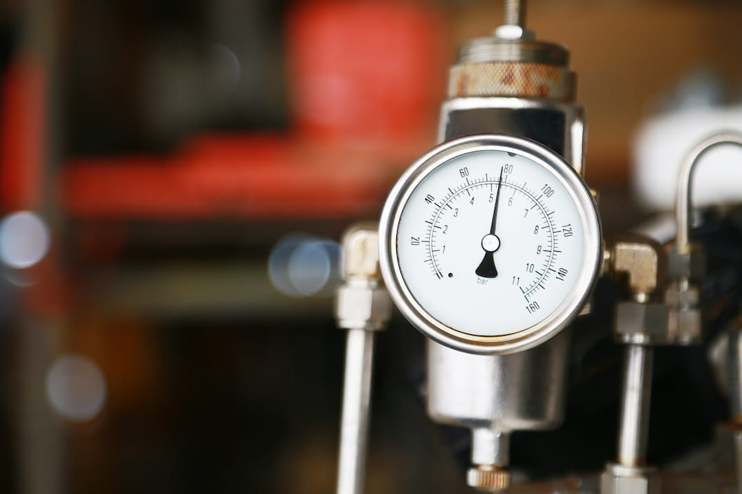 An industrial air compressor pressure thermometer.
