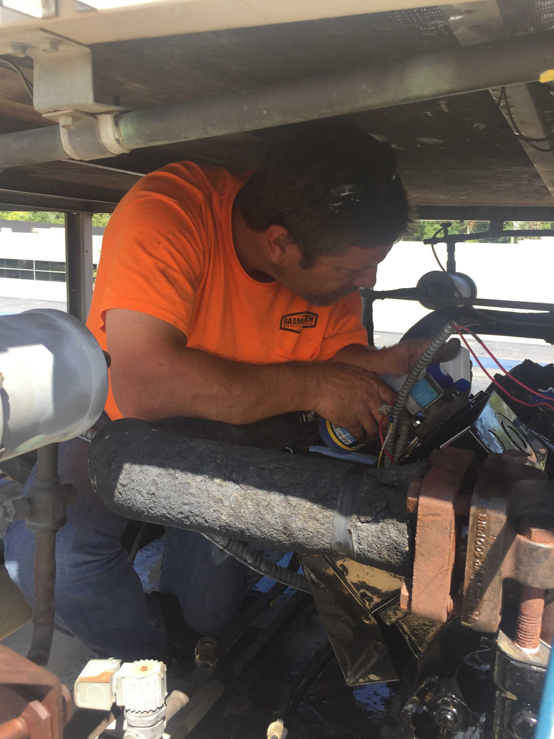 Technician servicing a leaking refrigerant line on an HVAC System in the Spring