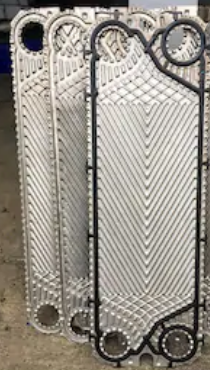Plates inside a plate and frame heat exchanger with gasket visible.