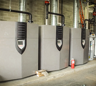 Three side by side Industrial Condensing Boiler Installed For A Facility.