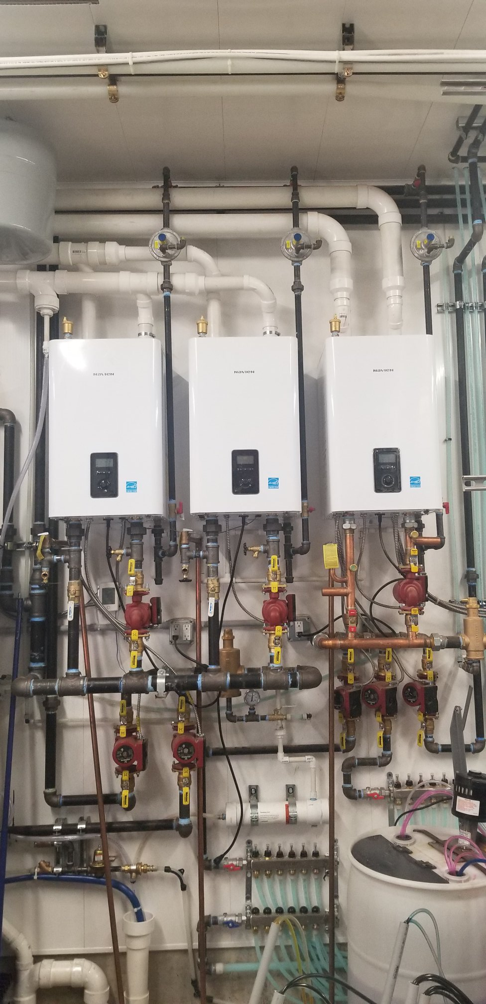 Three condensing boilers that are installed side by side