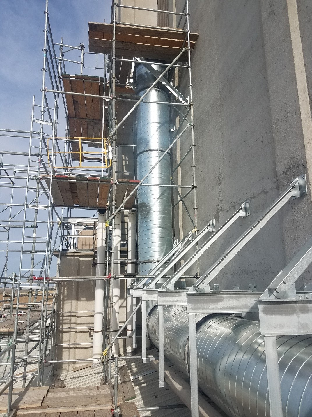 Completed commercial duct work with scaffolding around it