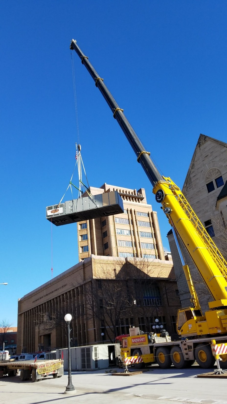 Trane IntelliPak being lifted with a crane to a rooftop