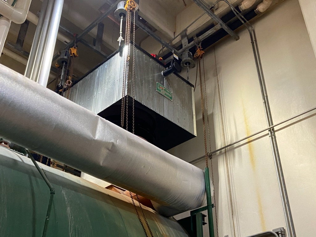 Economizer sitting on top of boiler