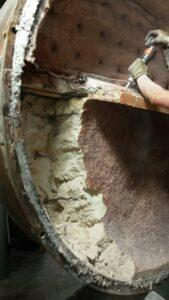 Technician removing boiler refractory on boiler door